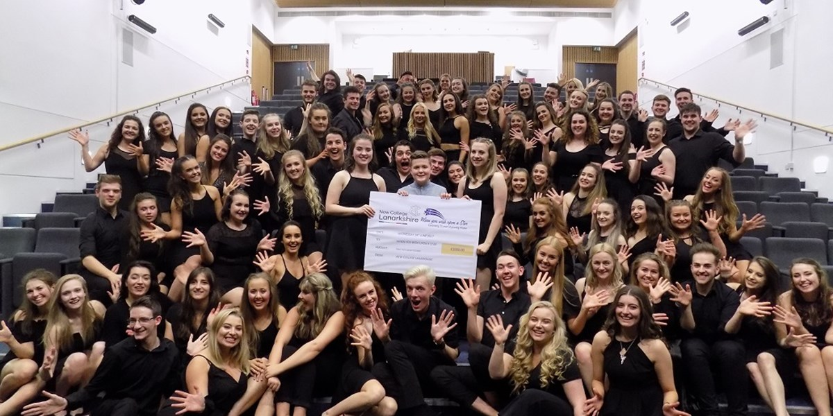 Musical theatre students present cheque to toby etheridge